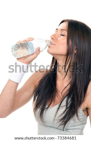 Pretty healthy young woman drinking pure mineral bottled water on a white background