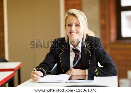 pretty high school student in classroom