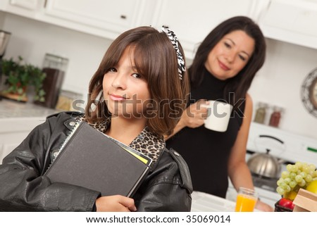 Pretty Hispanic Girl Ready for School with Mom in the Background.