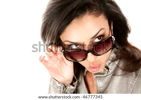 Pretty Hispanic woman looking over her glasses and whistling