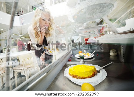 pretty hungry girl looking at tasty cake