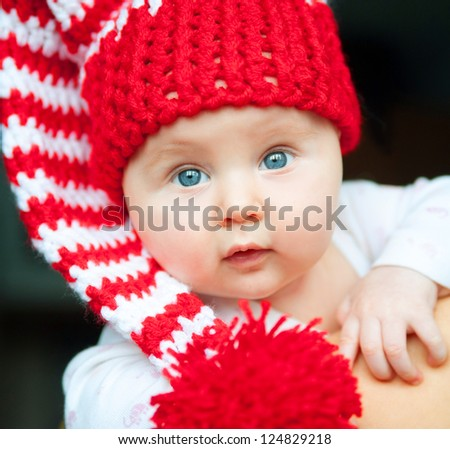 pretty infant in red hat