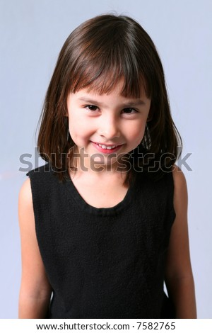 pretty little caucasian brunette girl with dimples smiling