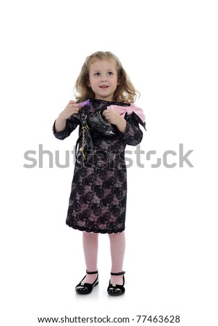 Pretty little child girl in black elegant party dress with lipstick. isolated
