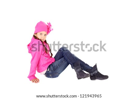 pretty little child in the jeans, pink jacket and cap - stock photo