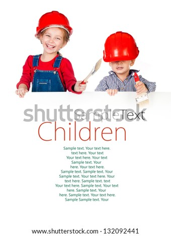 Pretty little girl and boy in halmet holding white banner with sample text
