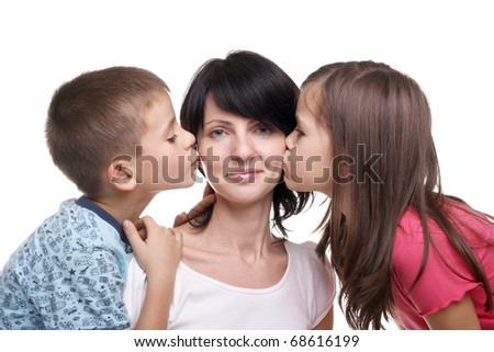 pretty little girl and boy kissing their mother
