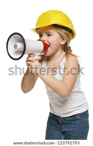 Pretty little girl builder in yellow helmet screaming into the loudspeaker, over white background