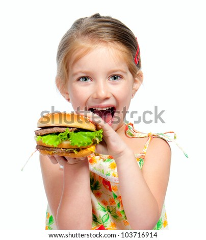 Pretty little girl eating a sandwich isolated on white background