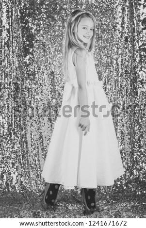 Pretty little girl in a white dress, fashion concept. #1241671672