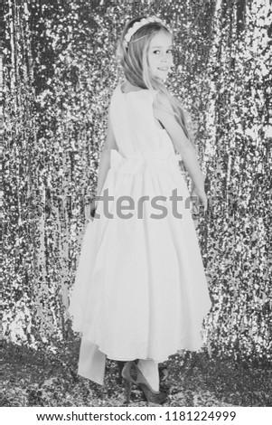 Pretty little girl in a white dress. smiling cute little girl. #1181224999