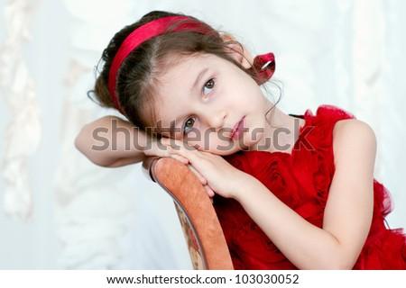 Pretty little girl in beautiful red dress