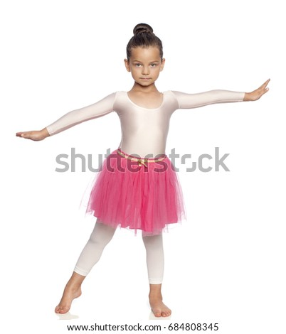 915ee6385 Pretty little girl in pink tutu training gym isolated on white ...