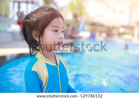 Free photos Cute little girl ready to swimming in the swimming pool ... 8bdae3fd1