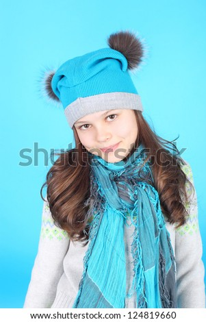 pretty little girl in the blue cap and scarf