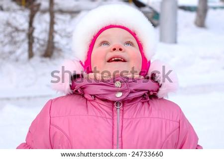 Pretty little girl in winter outerwear -  look up.
