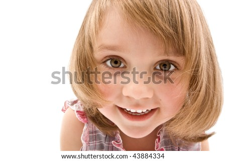 Pretty little girl looking in your eyes isolated on white.