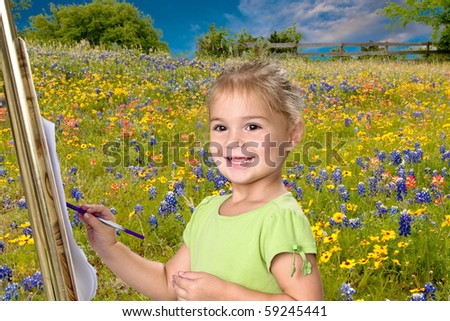 Pretty little girl painting bluebonnets on her easel.