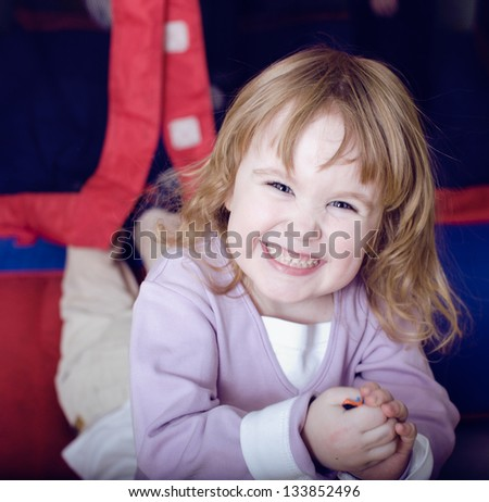 pretty little girl playing inside