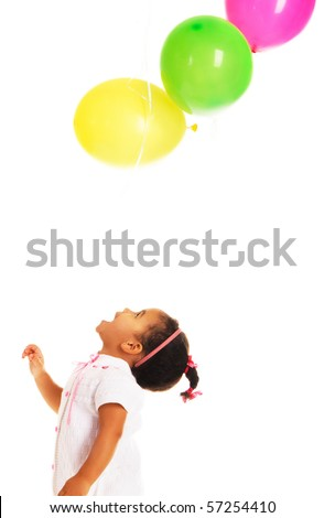 Pretty little girl playing with colorful balloons on white background