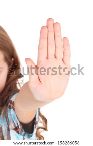 pretty little girl requiring stop with her hand, focus on the palm - stock photo