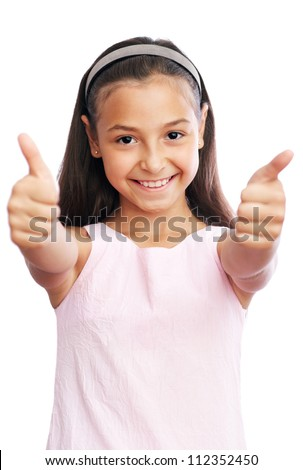 Pretty little girl showing thumbs up against white background