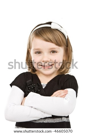 Pretty little girl smiling isolated on white.