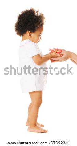 Pretty little girl taking a flower from woman's hands