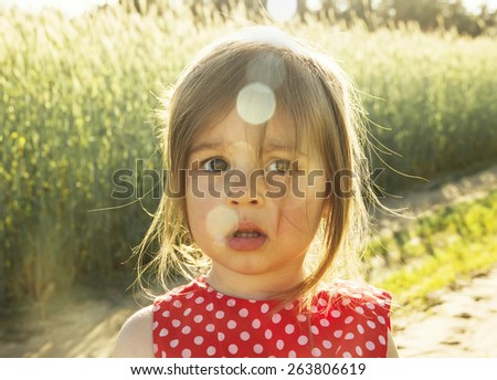 Pretty Little girl thinking at sunset