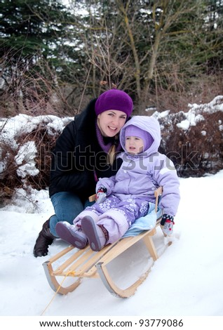 pretty little girl with her mother outdoors, winter