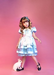 Pretty little girl with rabbit, Alice in wonderland, cute child