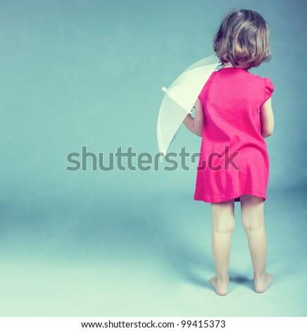 Pretty little girl with umbrella