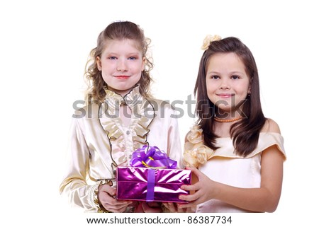 pretty little girls in the festive dresses with a gift