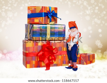 Pretty little gnome with christmas gifts on light shiny background