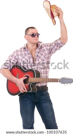 Pretty man with cowboy hat and guitar on white background