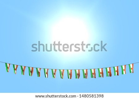 pretty many Niger flags or banners hangs on string on blue sky background - any holiday flag 3d illustration