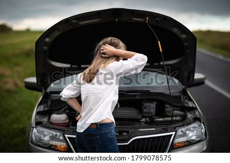 Pretty middle aged woman having car troubles - broken down car on the side of the road, calling the insurance company for assistance Сток-фото ©