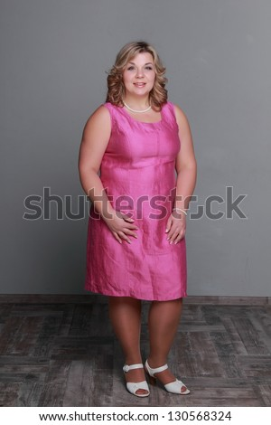 Pretty middle aged woman in a full-length
