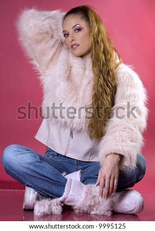 pretty model wearing pink fur coat and blue jeans