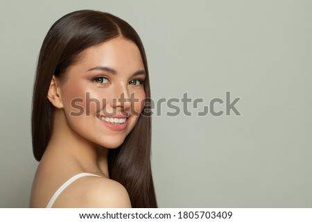 Pretty model woman with clear skin and long healthy straight hair. Skincare and facial treatment concept Сток-фото ©