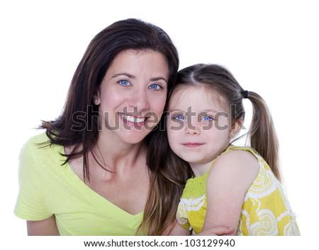 Pretty mother and daughter studio portrait on white - stock photo