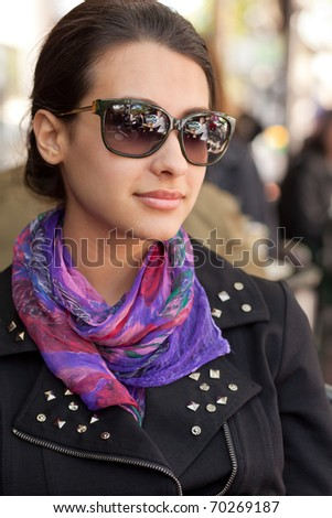 Pretty multicultural young woman at an outdoor restaurant cafe. - stock photo