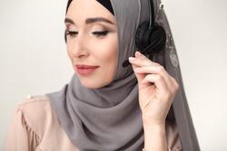Pretty muslim call center operator closeup portrait