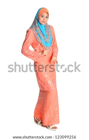 Pretty muslim woman model in catwalk action, on white background