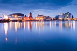 Pretty night time illuminations of the stunning Cardiff Bay, many sights visible including the Pierhead building (1897) and National Assembly for Wales.