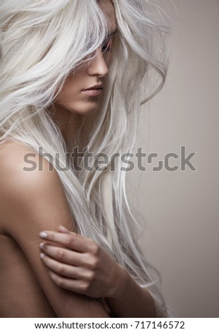 Pretty nude woman with a lush coiffure