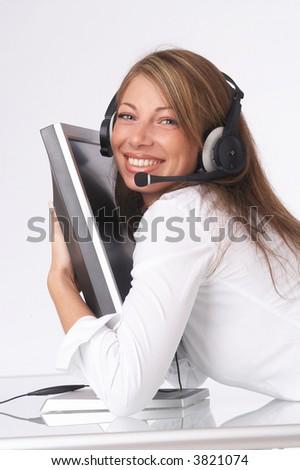 pretty operator hugging monitor happily