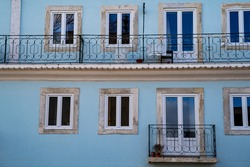 Pretty pale blue building facade, typical of Alfama neighborhood in Lisbon, Portugal