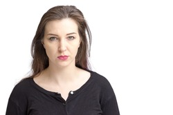 Pretty pale woman with dark hair and green eyes. Isolated on a white background, looking at camera not smiling.