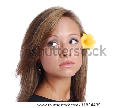 Pretty, Pensive Girl With Flower Over Ear